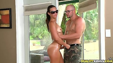 Sexy oil body Kelsi Monroe posing in various positions on the bed with fellatio