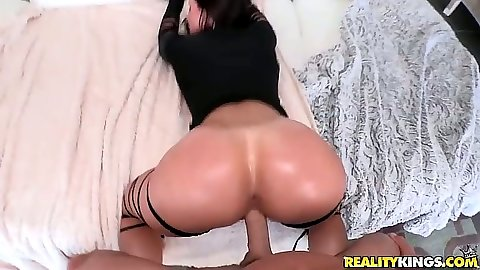 Oiled up ass Kendra Lust bends over to get thumb up her ass with hardcore fuck