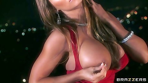 Madison Ivy is big tits lady in red solo stripping night time outdoors