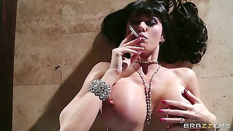 Eva Karera smoking milf with huge tits gets her feet touched