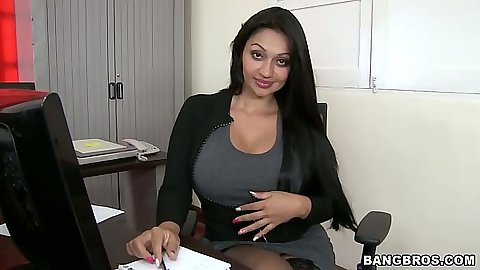 Office latina Cielo sits on table with dressed lifted up
