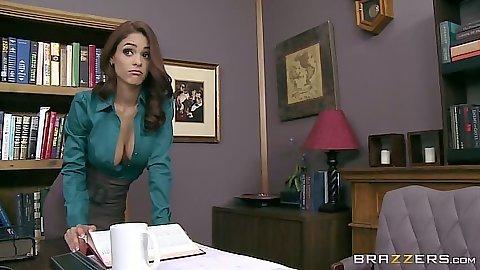 Solo office slut Jasmine Caro climbs on table and puts vibrator in