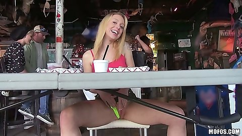 Blonde euro girl Lucy Tyler gives a peak up her skirt under the table
