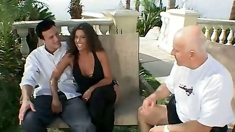 Wife Aries talks with husband and another man outdoors