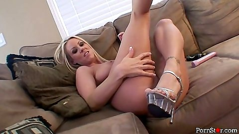 Posing Carolyn Reese naked and loving her sex toy and big tits nipples