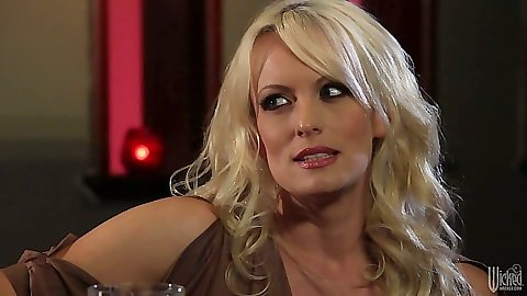 Blonde milf babe Stormy Daniels makes out and kisses guy in bedroom