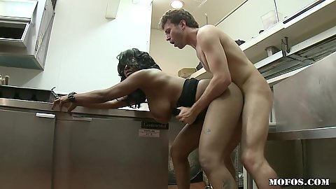 Black slut sucks off customer in the diners kitchen