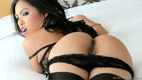 Asian babe Cindy Starfall propping up her ass and spreading legs