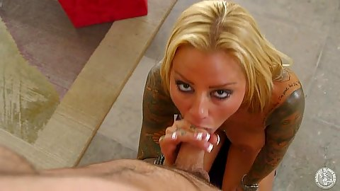 Milf Brittany Shannon kneeling for a blowjob on kitchen floor