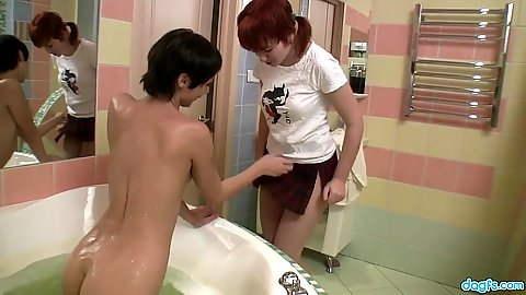 Teen invites her friend for lesbian wet sex in bath tub