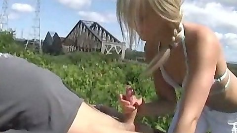 Handjob and fingering half dressed teen outdoors and a blowjob