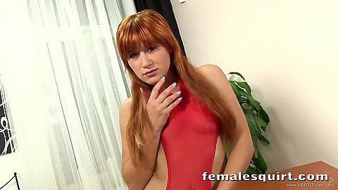 Redhead lingerie girl inserting dildo up her twat