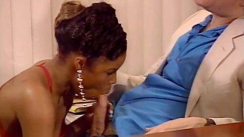 Ebony Angel Kelly sucking white cock in office