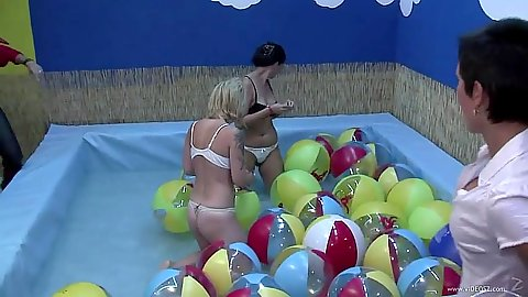 Amateur college chicks jump in the pool to get wet at a party