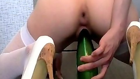 Girl sits on a thick bottle with her pussy and gliding it in Strawberry