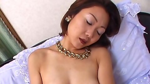 Asian girl cuddles with her own tits