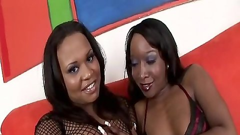 Two ebony lesbians in revealing fishnets Kandi Kream and Stacey Cash