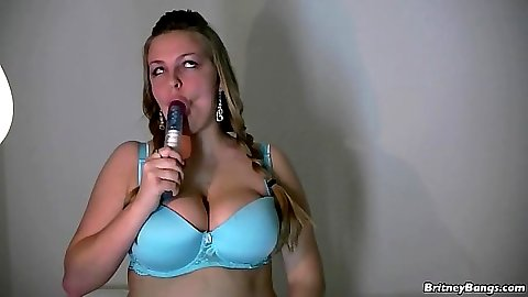 Sucking her dildo and then putting it in Britney Bangs