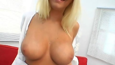 Stunning busty Riley Evans shows off her boobs and spreads ass