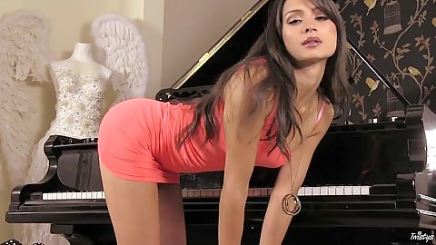 Teasing brunette Chelsea French looking hot in a tight dress