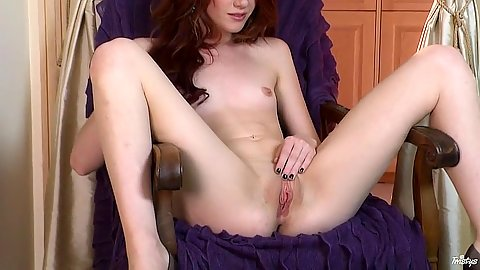 Open wide redhead sitting naked in the chair solo Elle Alexandra