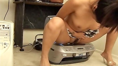 Naughty asian hooker Asia sits on the scanner