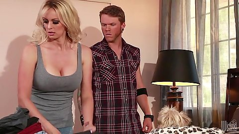 Fully clothed Stormy Daniels in softcore scene