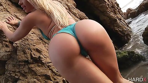 Anikka Albrite posing her lovely ass outdoors on the beach getting all wet