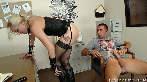 Chick tied up in leather sitting on cock in the office