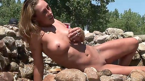 Outdoor girl posing in a pool with natural wet body