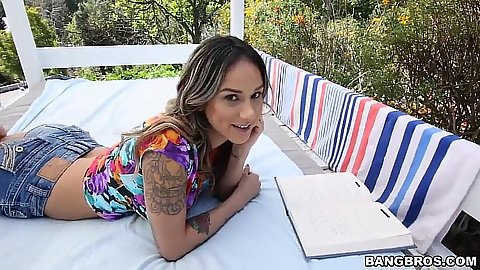 Sweet looking Nadia Styles shows her tits and tight ass in jean shorts outdoors