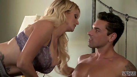 Blonde milf with large melons in her bra does dirty blowjob Stormy Daniels
