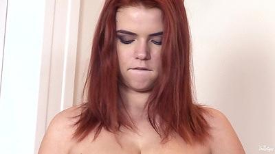 Redhead girl with flipping boobies squats on ground Marina Visconti