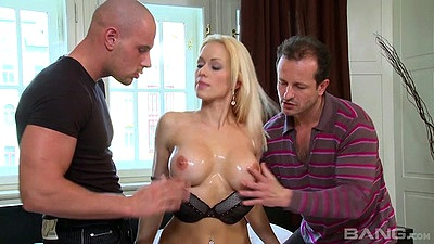 Inviting big boobs Stacy Silver gets her boobs oiled up and goes for threesome