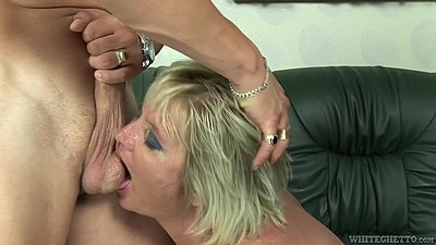 Mature Zuzana A sucking some balls and then climbs on young mans penis