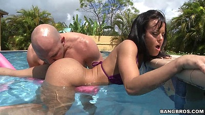 Refined bikini Rahyndee getting wet and horny in the pool