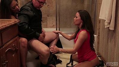 Asian Kaylani Lei and Kalina Ryu lock man in toilet to suck him off