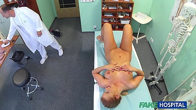 Naked girl on doctors exam table laying there all wet