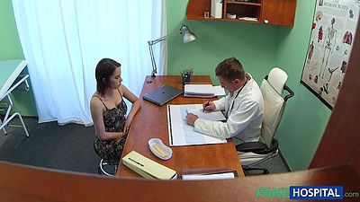 Doctor talks with busty beauty in his office