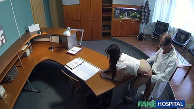 Bent over nurse receptionist receiving one from the doctor