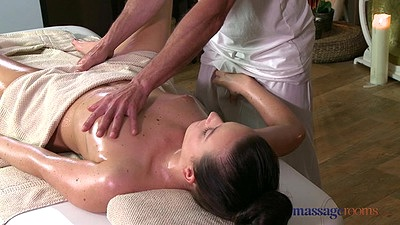 Natalie reaches for her male masseuse penis while he is rubbing oil on her