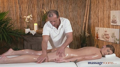 Bella is naked during oil massage and kisses masseuse