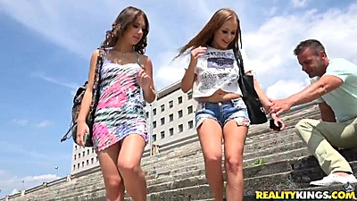 Outdoor skinny Katarina Muti and Lily G wearing tight clothes meeting some dudes