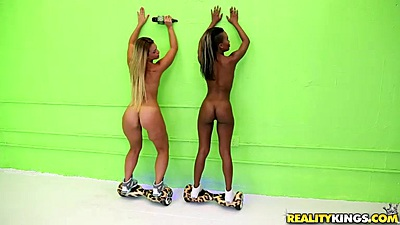 Anya Olsen and Lucy Doll posing their asses naked on skate boards