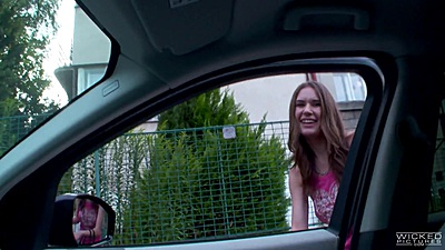 Playful skinny college teen Nadia Bella jumps in car and flashes boobs