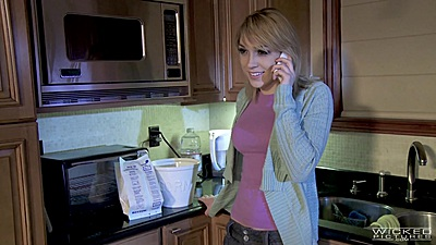 Fabulous blond Lily Labeau talks on phone