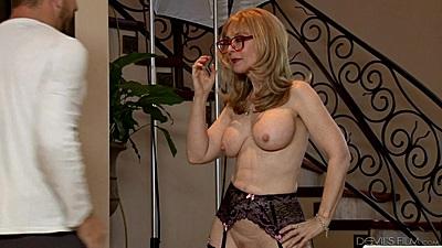 Big boobs milf in lingerie walking around in behind the scenes