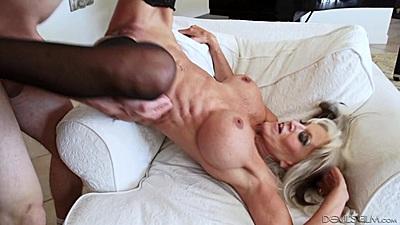 Lusty granny with really big boobs Sally D nailed over sofa arm