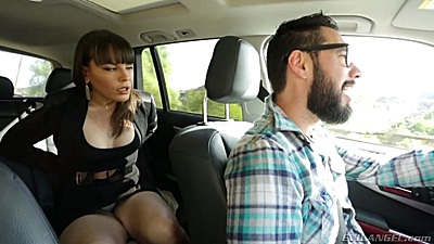 Captivating milf Dana DeArmond relaxing in the backseat