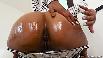 Oiled up great ebony ass Yasmine de Leon on chair solo spreading pussy lips